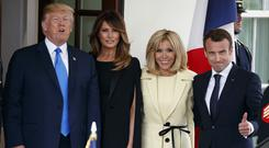 Donald and Melania Trump greet Emmanuel and Brigitte Macron