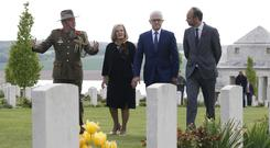 Australian Colonel Scott Clingan escorts Edouard Philippe and Malcolm Turnbull and his wife Lucy at the military cemetery (Pascal Rossignol/AP)