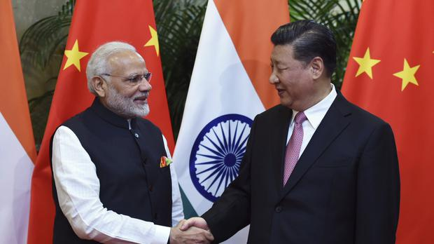 Indian Prime Minister Narendra Modi shakes hands with Chinese President Xi Jinping (Indian Ministry of External Affairs via AP)