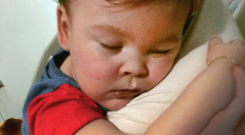 Now at peace: Family handout photo of Alfie Evans cuddling his mother Kate James. Photo: PA