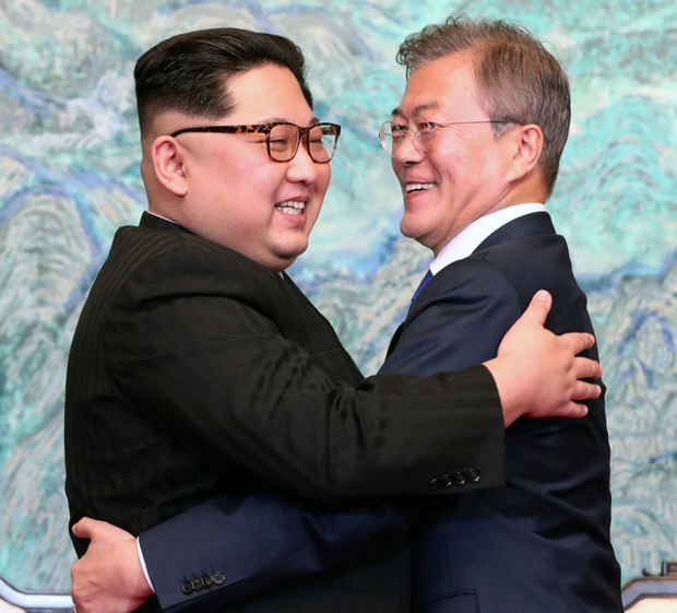 Peace? North Korean leader Kim Jong-un, left, and South Korean president Moon Jae-in embrace after signing last week's joint statement. Photo: AP
