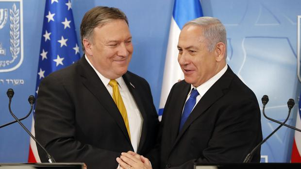 Mike Pompeo. left. is greeted by Benjamin Netanyahu (Thomas Coex, AFP via AP)