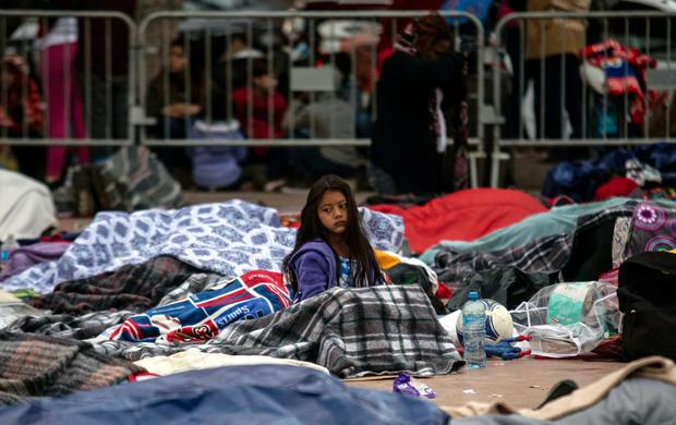 "Central American migrants travelling in the ""Migrant Via Crucis"" caravan bed down outside ""El Chaparral"" port of entry to US. Photo: AFP/Getty Images"