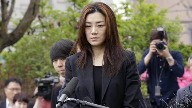 Former Korean Air senior vice president Cho Hyun-min arrives at a police station in Seoul (Ahn Young-joon/AP)
