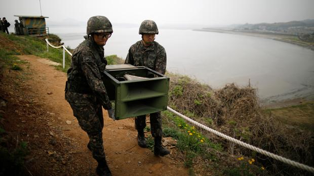 South Korean soldiers move loudspeakers near the demilitarised zone in Paju (Kim Hong-Ji/Pool Photo via AP)