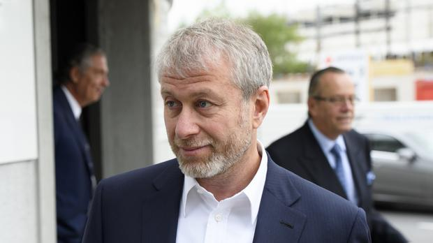 Mr Abramovich outside the court in Fribourg (AP)