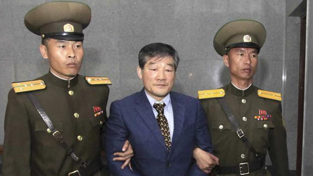 Kim Dong Chul was detained in North Korea (Kim Kwang Hyon/AP)