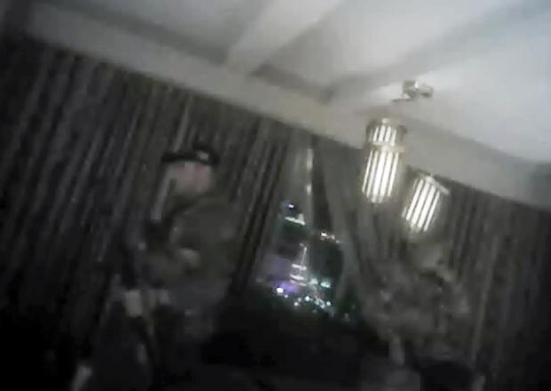 Body camera footage showing an officer carrying an assault rifle past a broken-open window at the Mandalay Bay Hotel (Las Vegas Metropolitan Police Department/AP)