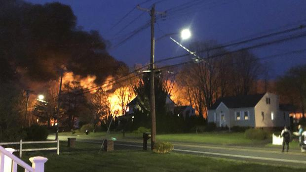 A fire behind a house in North Haven (Kevin Galliford/WFSB-TV via AP)