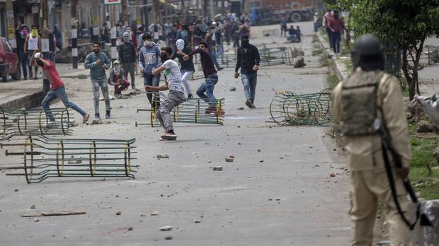 Kashmiri protesters clash with Indian paramilitary soldiers in Srinagar (Dar Yasin/AP)