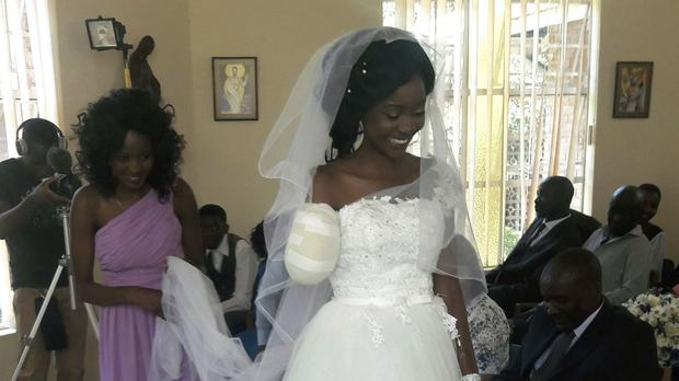 The bride walks down the aisle on her wedding day at a hospital chapel in Bulawayo, Zimbabwe (AP)