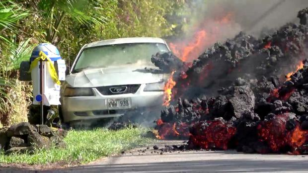 Lava engulfs a car in Puna, Hawaii. Photo: Reuters handout