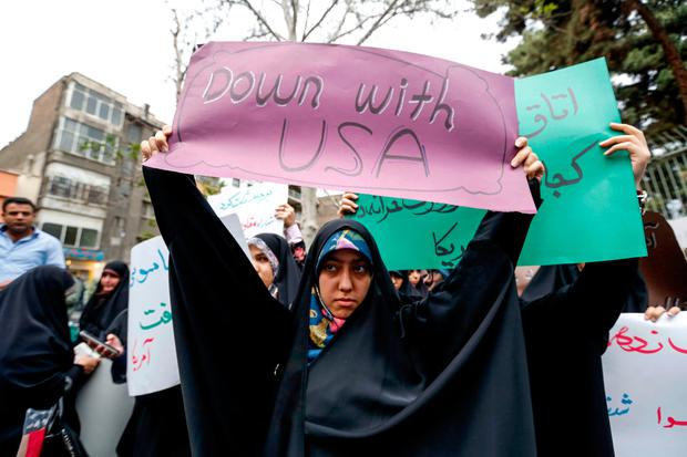 A protester in Tehran vents her disapproval of the United States' withdrawal from the Iran nuclear deal. Photo: AFP/Getty