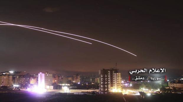Missiles rise into the sky as Israeli missiles hit air defence position and other military bases, in Damascus (Syrian Central Military Media/AP)