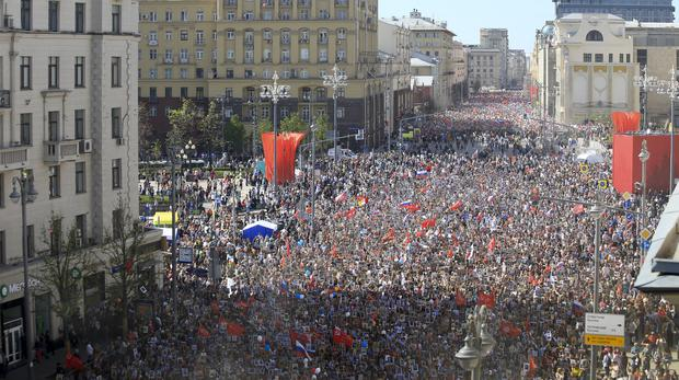Thousands took to the streets of Moscow (Pavel Ogorodnikov/AP)