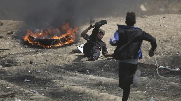 Protests at the Gaza Strip's border with Israel (Khalil Hamra/AP)