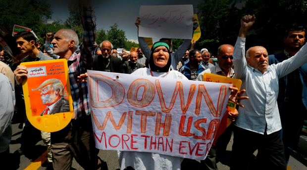 Iranians hold anti-US slogans during a demonstration after Friday prayer in the capital Tehran last week. Photo: AFP/Getty Images