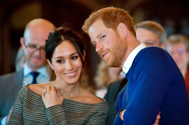 LOVE MATCH: Meghan Markle with husband-to-be Prince Harry. Photo: AFP/Getty Images