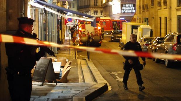 Police officers cordon off the area after a knife attack in central Paris (AP Photo/Thibault Camus)