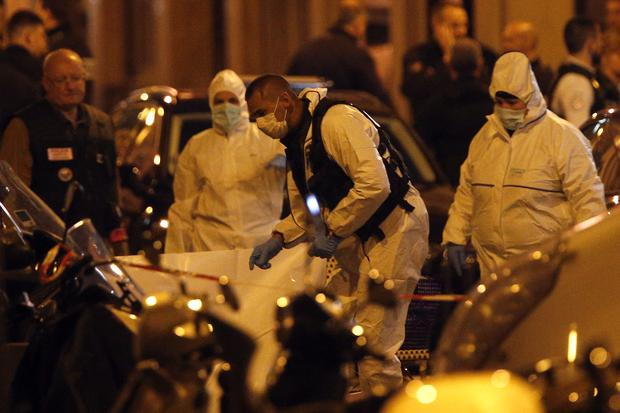 Forensic officers investigate at the scene (Thibault Camus/AP)