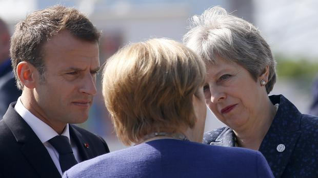 Angela Merkel speaks with Emmanuel Macron and Theresa May in Sofia, Bulgaria (Darko Vojinovic/AP)
