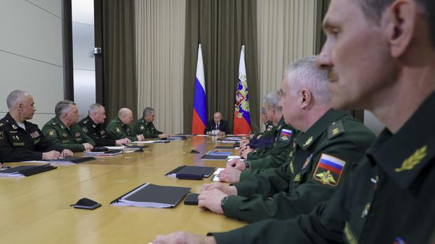 Russian President Vladimir Putin at a meeting with the top military brass (Mikhail Klimentyev, Sputnik, Kremlin Pool Photo via AP)