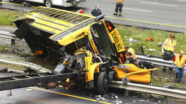 Emergency personnel examine a school bus after it collided with a dump truck in Mount Olive, New Jersey (Bob Karp/The Daily Record via AP)