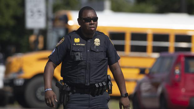 A police officer at the scene of a shooting at Santa Fe High School. (Stuart Villanueva /The Galveston County Daily News via AP)