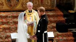 RING OF HISTORY: Prince Harry and Meghan Markle exchange vows in St George's Chapel at Windsor Castle before Archbishop of Canterbury Justin Welby. Photo: Owen Humphreys