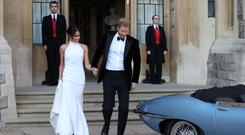 GOLDEN COUPLE: Meghan and Harry leaving for the evening reception at Frogmore House. Picture: Reuters