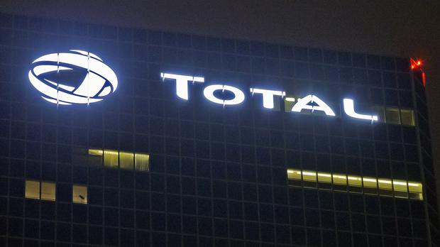Total is looking to pull out of Iran amid after the US signalled continued sanctions (AP)