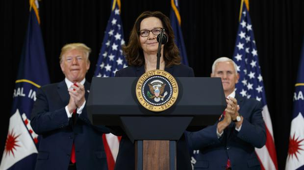 Donald Trump and Mike Pence applaud incoming Central Intelligence Agency director Gina Haspel (AP)