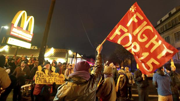 Protesters gather outside a McDonald's restaurant in Minneapolis during a 2016 demonstration for higher wages (David Joles/AP)