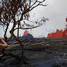 Fissures spew lava in the Leilani Estates subdivision near Pahoa, Hawaii (Jae C Hong/AP)