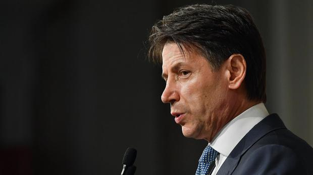 Giuseppe Conte addresses the media (Ettore Ferrari/ANSA/AP)