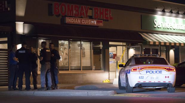 Police outside a restaurant in Mississauga, Canada after an explosion. (Doug Ives/The Canadian Press via AP)