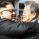 North Korean leader Kim Jong Un and South Korean President Moon Jae-in embrace (South Korea Presidential Blue House/Yonhap/AP)