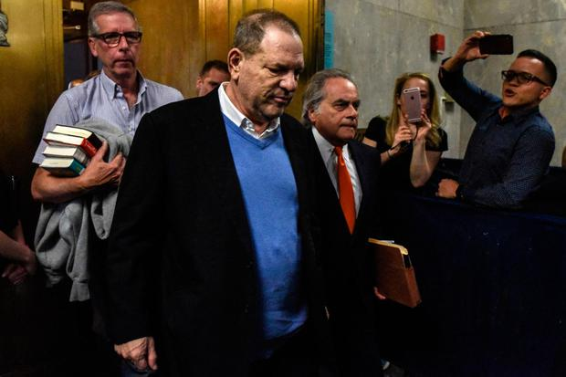 ACCUSED: Harvey Weinstein leaves court with his lawyer Benjamin Brafman. Photo: Getty