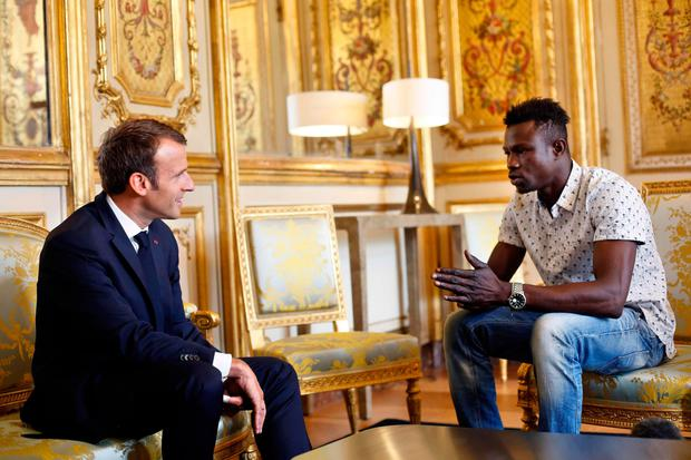 President Emmanuel Macron, left, speaks with Mamoudou Gassama at the presidential Elysee Palace. Photo: AFP/Getty