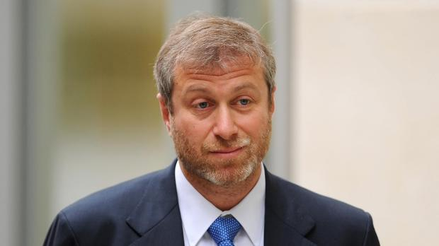 Abramovich sued over oil shares