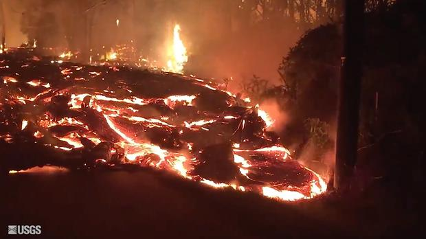 Lava flowing onto Kaupili Street in the Leilani Estates area (USGS/AP)