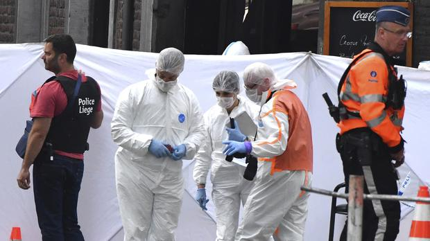 Forensic police investigate at the scene of a shooting in Liege, Belgium (AP)