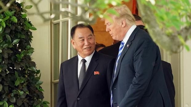 Donald Trump talks with North Korea's Kim Yong Chol at the White House (Andrew Harnik/AP)