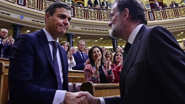 Mariano Rajoy, right, shakes hands with Pedro Sanchez (Pierre Phillipe Marcou/AP)