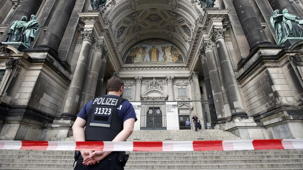 A police officer stands in front of the cathedral in Berlin (Michael Sohn/PA)