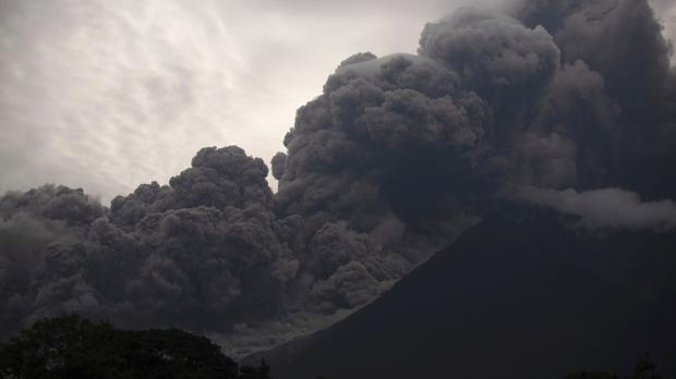Volcan de Fuego blows outs a thick cloud of ash, as seen from Alotenango, Guatemala (Santiago Billy/AP)