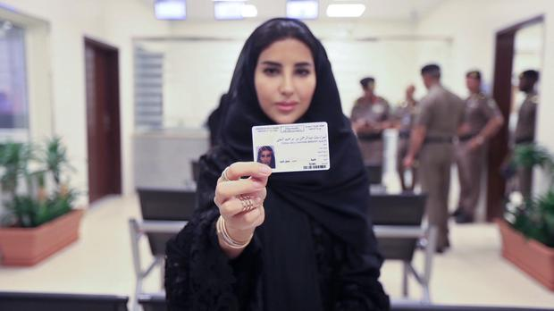 Esraa Albuti displays her brand new driving licence (Saudi Information Ministry via AP)
