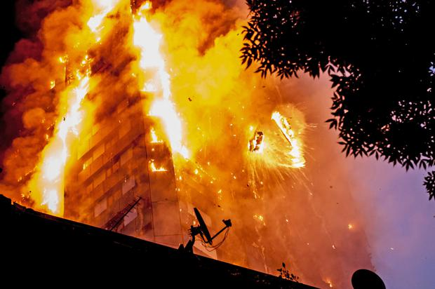 Falling burning debris at the scene of the Grenfell Tower fire in London last June. Photo: Guilhem Baker/LNP