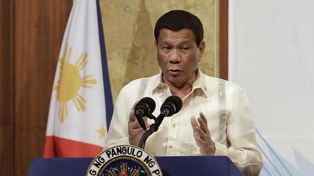 Philippine President Rodrigo Duterte spoke after returning from South Korea (AP)