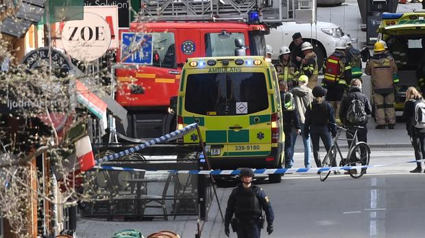 Emergency services at the scene of the attack in central Stockholm (Fredrik Sandberg/TT via AP)